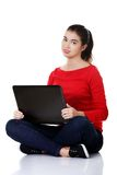 Front view woman sitting cross-legged with laptop Royalty Free Stock Image