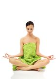Front view woman sitting excercising yoga Royalty Free Stock Photos