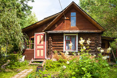 Front view of wooden house in russian village stock image