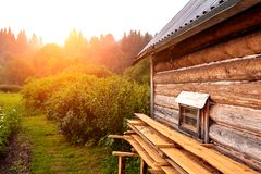 Front view of wooden house in russian village in sunny summer day stock photography