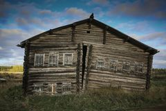Front view of wooden log house in Russian village stock photos