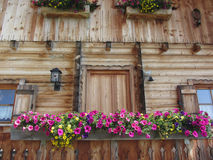 Front view of a wooden mountain cabin . Sesto Dolomites, South Tyrol, Italy Stock Photos