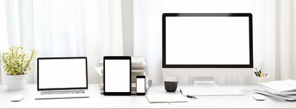 Front view of workpark with blank white computer screen,tablet and smart phone, and book in home work. Mock up,. 3D. Front view of workpark with blank white Stock Images