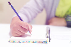 Front view of writing hand Stock Images
