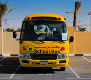 A front on view of a yellow Arabic school bus Stock Photo