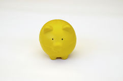 Front view of a yellow pig toy Royalty Free Stock Photography