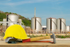 Front view of Yellow Safety Helmet, Hammer, Cutting tools on Oil Stock Photos