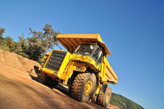 Front view of yellow tipper truck Stock Image