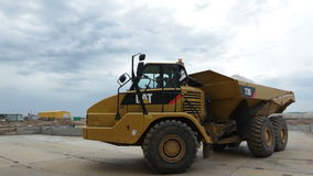Front view yellow tipper truck with gypsum drives on ground stock video footage