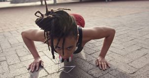 Front view of young African American woman exercising in the city 4k stock video