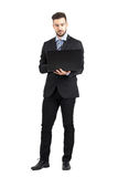Front view of young bearded corporate man working on laptop Stock Photo