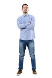 Front view of young confident corporate ceo with crossed arms looking at camera. Full body length portrait isolated over white background royalty free stock photos