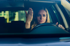 Young frustrated woman driving car royalty free stock photos