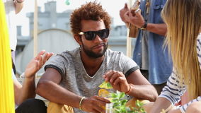 Front view of young man having fun with friends at rooftop party stock video footage