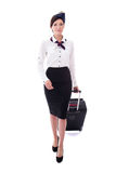 Front view of young stewardess walking with suitcase isolated on Stock Image