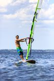 Front view of young windsurfer Stock Images