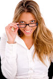 Front view of young woman holding eyewear Stock Images