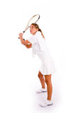 Front view of young woman playing tennis Royalty Free Stock Images