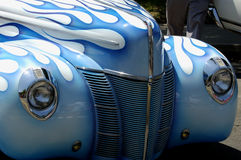 Front of vintage car. White with blue flames paint job stock photography