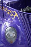 Front of Vintage Car. Purple with yellow and red flames paint job Royalty Free Stock Photography