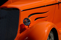 Front of vintage car in detail. Front side of vintage car with cut flames royalty free stock photos