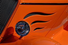 Front of vintage car in detail. Front side of vintage car with cut flames royalty free stock images