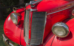 The front of a vintage red car Royalty Free Stock Image