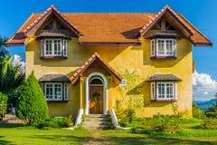 Front of vintage yellow European style house Stock Photos