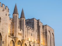 Front side of Papal Palace in Avignon. Front wall side of Papal Palace in Avignon, France, under twilight night sky. One of the UNESCO World Heritage place in stock images