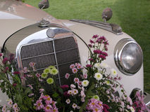 Front of wedding car bouquet. A white oldtimer with a wedding bouquet Stock Photo