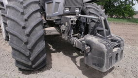 Front weighting tractor stock video footage