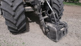 Front weighting tractor stock footage