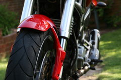 Front Wheel. Motorcycle front wheel with the side of bike out of focus in the background stock photo