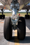 Front wheel. Of domestic aircraft standing at airfield Royalty Free Stock Photography