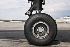 Front wheel. Of domestic aircraft standing at airfield Royalty Free Stock Photos