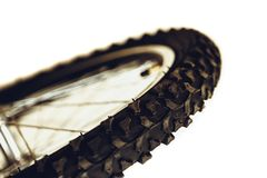 Front wheel of bicycle. Rubber bicycle tire close-up. Mountain bike. Wheel protector profile. stock image