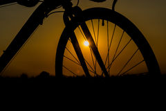 Front wheel bike. Front wheel of a bicycle silhouette on sunset Stock Photos