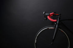 Front and wheel of black race road bike. The front and wheel of black race road bike Royalty Free Stock Photo