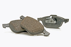 Front wheel brake pads set. Automobile brake pads on a white background Stock Image