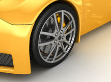 Front wheel of a bright yellow car Royalty Free Stock Photo