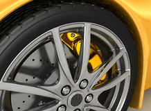 Front wheel of a bright yellow car Royalty Free Stock Images