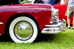 Front wheel of burgundy classic car Royalty Free Stock Photography