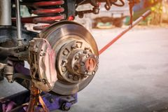 Car repair industry. The front wheel of the car was removed to repair the brake system, Automotive industry and garage concepts Royalty Free Stock Photography