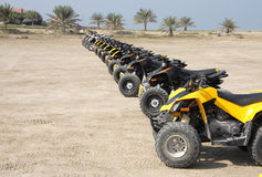 Front wheel of desert scooter arranged in a row Stock Photo