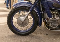 Front wheel detail of a blue motorcycle motor wing close-up techno. Background Stock Photography
