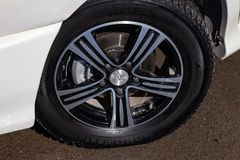 Front wheel with disk view of Toyota Ipsum 1998 year in white color after cleaning before sale on parking. Novosibirsk, Russia - 04.10.2019: Front wheel with stock photo