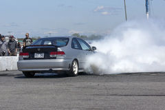 Front wheel drive car. Napierville dragway, canada - may 18, 2014 rear side view of honda civic car front wheel drive during smoke show exhibition on the track Stock Photography