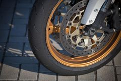 Front wheel and drive of a racing motorcycle royalty free stock photos