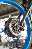 Front wheel electric bike with engine and brake disk. Closeup stock photo