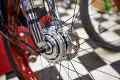 Front wheel with electric motor of modern bicycle. Front wheel with an electric motor of the modern bicycle royalty free stock image